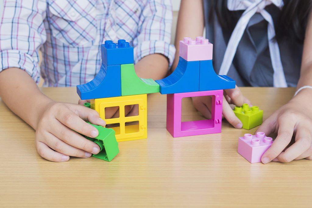 Kids playing pieces plastic creative construction blocks